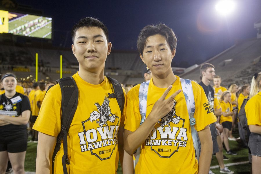 Chris Wu and Vincent Gu pose for a portrait at the Kickoff at Kinnick for On Iowa! on Friday, August 23.