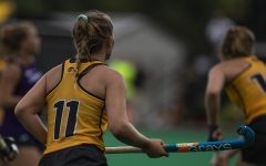 Iowa midfielder Katie Birch watches teammates during an exhibition game against Northwestern at Grant Field on Saturday, August 24, 2019. The Hawkeyes defeated the Wildcats 3-2.