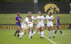 Iowa team members high five each other following a goal during a match against the University of Northern Iowa Panthers on Sunday, August 25, 2019. The Hawkeyes defeated the Panthers 6-1. (Emily Wangen/The Daily Iowan)