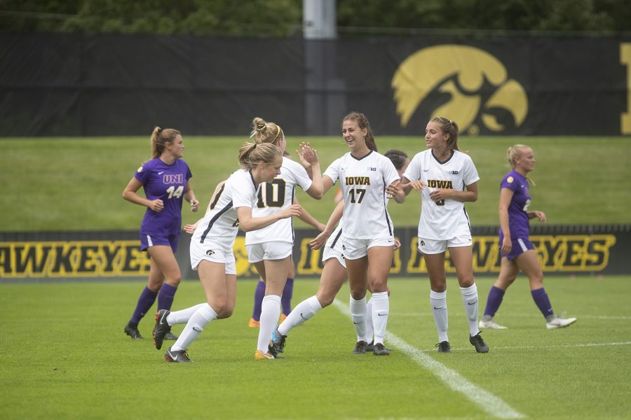 Iowa+team+members+high+five+each+other+following+a+goal+during+a+match+against+the+University+of+Northern+Iowa+Panthers+on+Sunday%2C+August+25%2C+2019.+The+Hawkeyes+defeated+the+Panthers+6-1.+%28Emily+Wangen%2FThe+Daily+Iowan%29