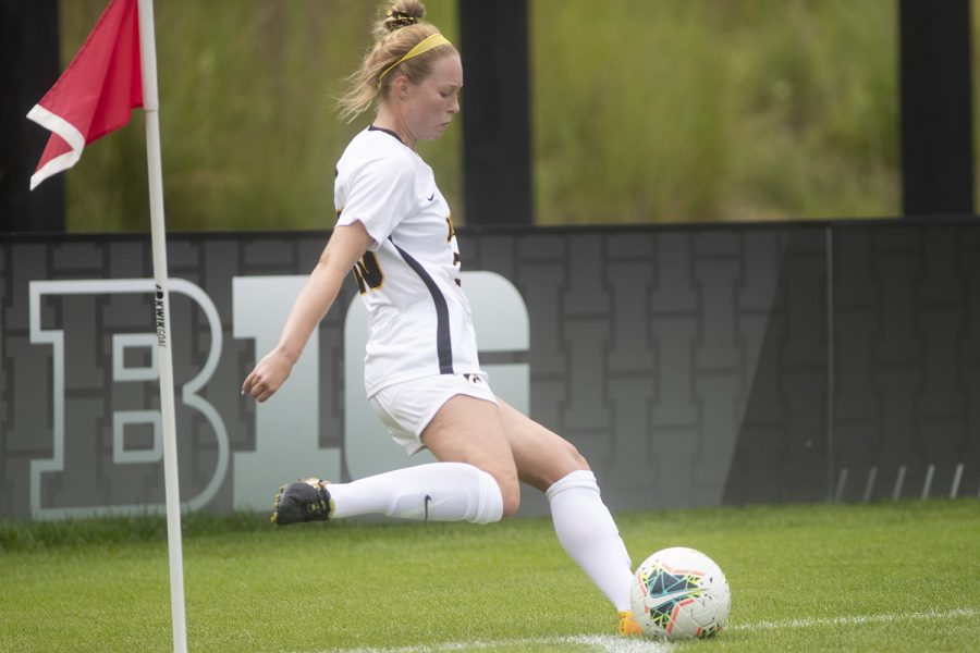 Iowa's Natalie Winters completes a corner kick during a match against the University of Northern Iowa Panthers on Sunday, August 25, 2019. The Hawkeyes defeated the Panthers 6-1.