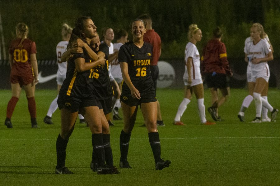 Iowa players hug at the end of a women's soccer match between Iowa and Iowa State on Thursday, August 29, 2019 at the Iowa Soccer Complex. The Hawkeyes defeated the Cyclones, 2-1.