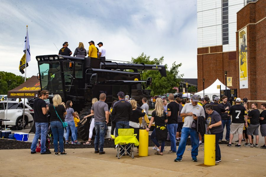 Hawkeye+fans+take+turns+taking+pictures+of+the+Iowa+Corn+tractor+outside+of+Kinnick+Stadium+on+August+31%2C+2019.