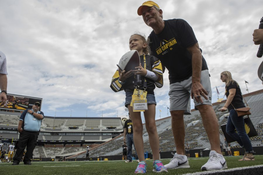 Kid+Captain+Charlotte+Keller+and+Iowa+football+head+coach+Kirk+Ferentz+pose+for+a+picture+on+Kinnick%27s+field+at+Kids+Day+at+Kinnick+on+Saturday%2C+Aug.+10%2C+2019.+Kids+Day+at+Kinnick+is+an+annual+event+for+families+to+experience+Iowa%27s+football+stadium%2C+while+watching+preseason+practice+and+honoring+this+year%27s+Kid+Captains.+