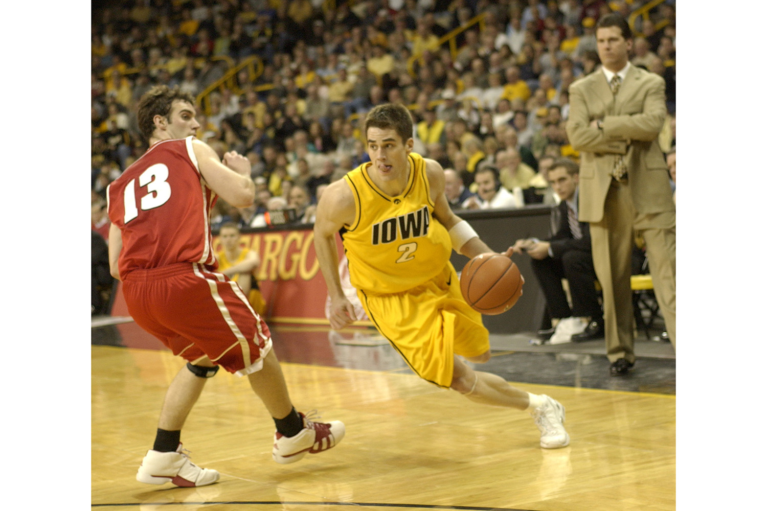 Ben Roberts/The Daily Iowan University of Iowa starting point guard Jeff Horner flies past Wisconsin's Clayton Hanson during a 54-52 loss to the Badgers on Wednesday evening in Iowa City.