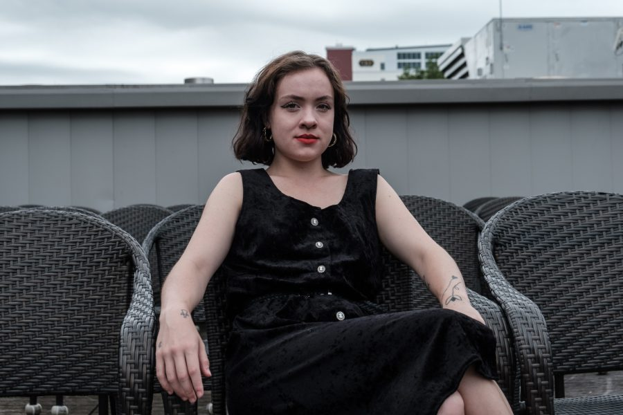Molly Bagnall poses for a portrait in front of Film Scene in Iowa City on Monday, August 19, 2019.