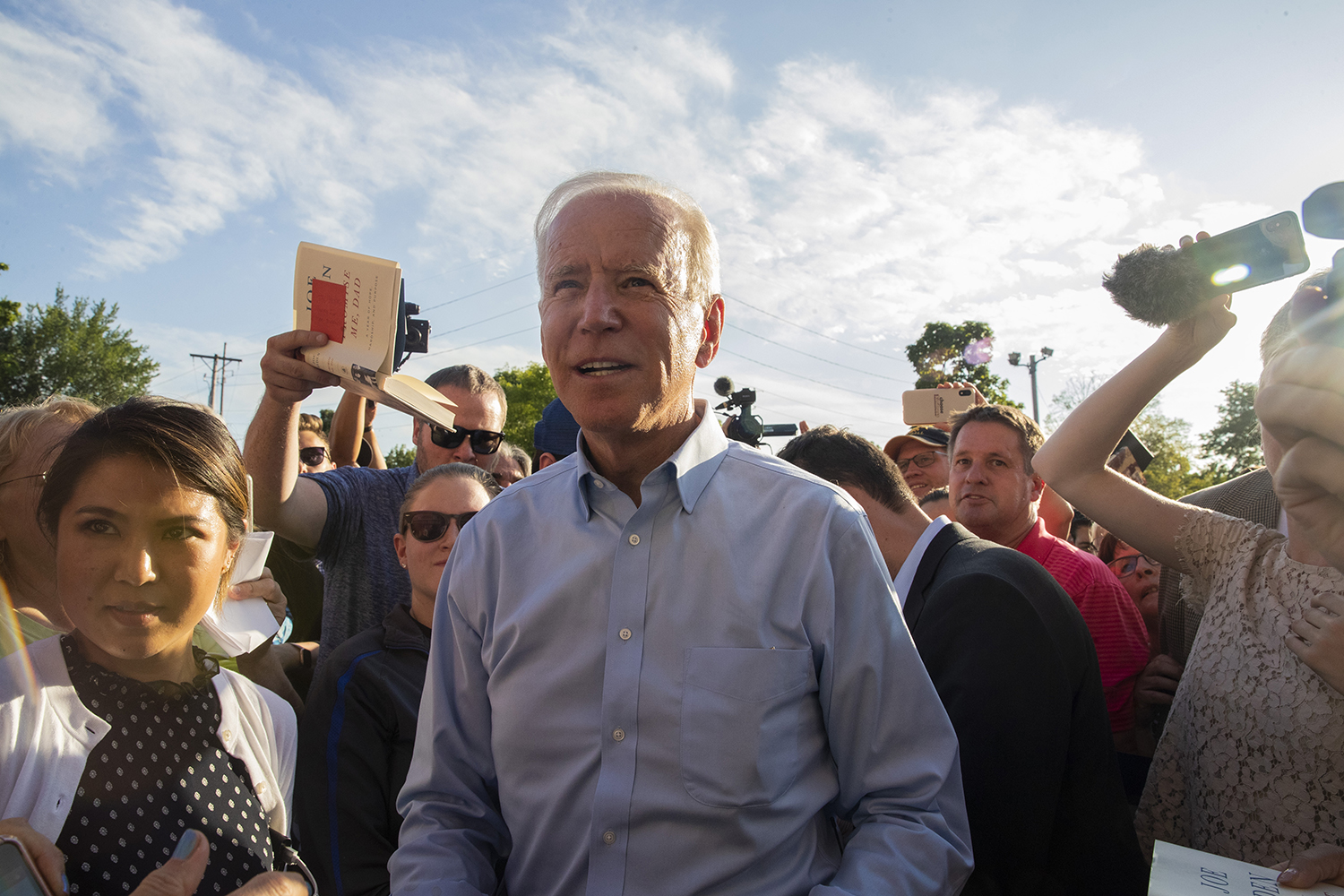 Former Vice President and 2020 democratic candidate Joe Biden greets attendees at the opening of his campaign office on S. Gilbert St. on Wednesday, August 7, 2019. (Jenna Galligan/The Daily Iowan)