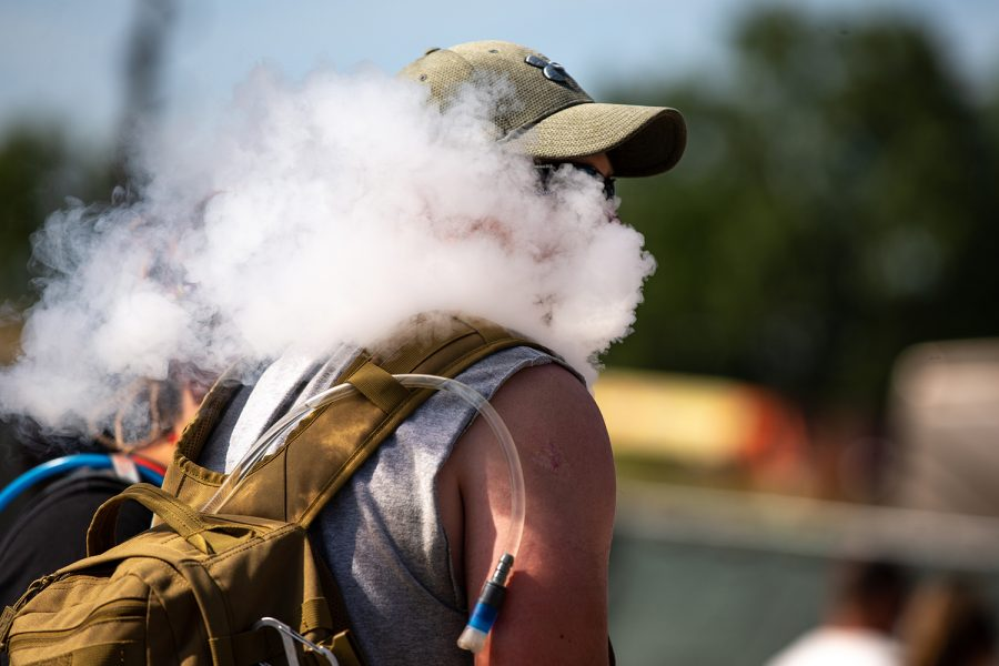A man blows a cloud of vape while at the Hinterland Music Festival on August 2, 2019 in Saint Charles, Iowa.