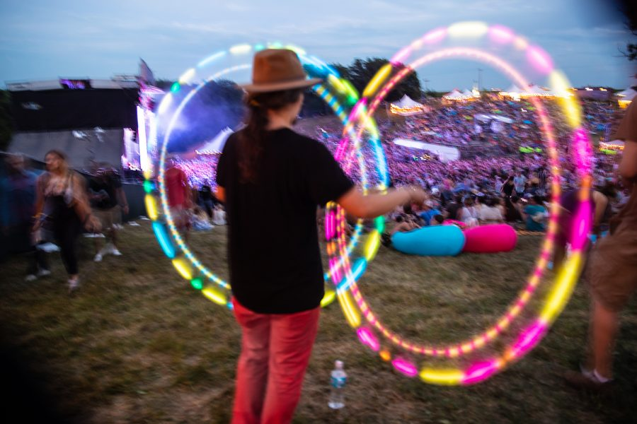 An attendee at Hinterland Music Festival spins lights on August 3, 2019 in Saint Charles, Iowa.