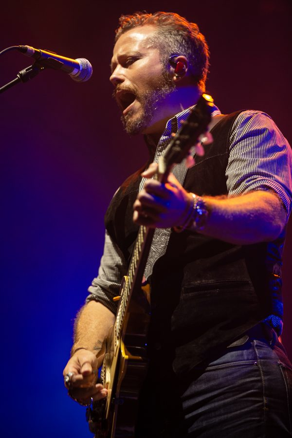 Jason Isbell sings a song and plays the guitar at Hinterland music festival on August 3, 2019 in Saint Charles, Iowa.