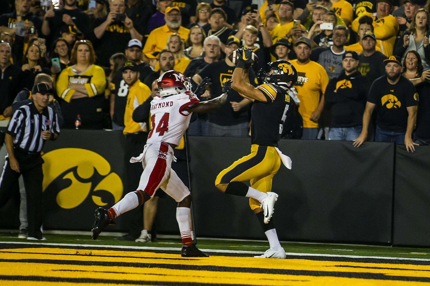 Iowa wide receiver Oliver Martin catches a touchdown pass during the football game against Miami (Ohio) at Kinnick Stadium on Saturday, August 31, 2019.