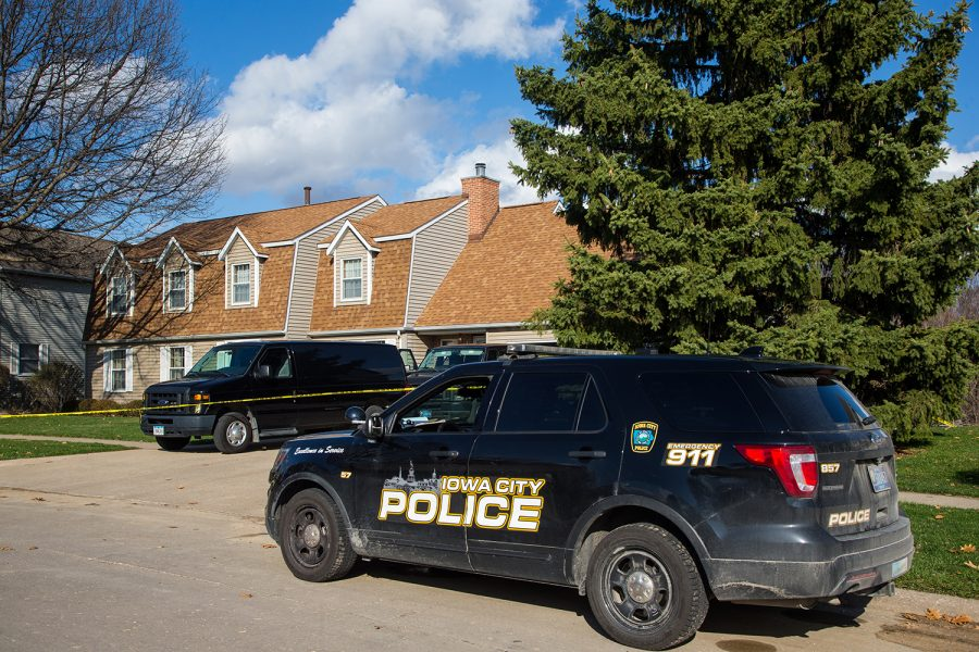 Police investigators respond to a scene of a suspicious death on Friday, April 7, 2019, at 114 Green Mountain Drive in Iowa City, Iowa.