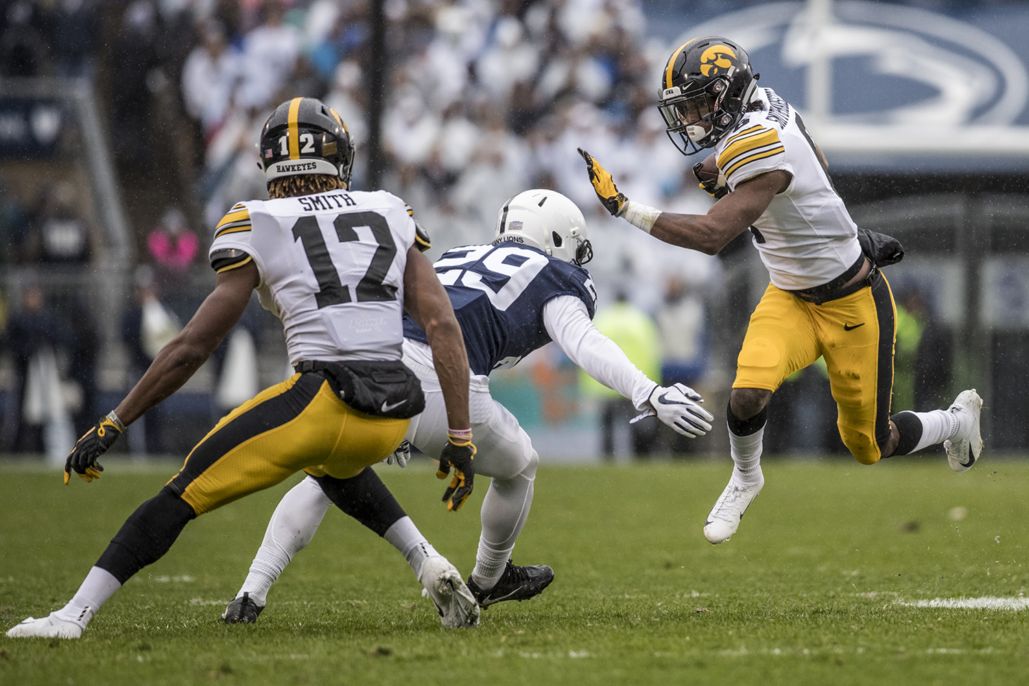 Iowa wide receiver Ihmir Smith-Marsette avoids a defender during Iowa's game against Penn State at Beaver Stadium on Saturday, October 27, 2018. The Nittany Lions defeated the Hawkeyes 30-24.