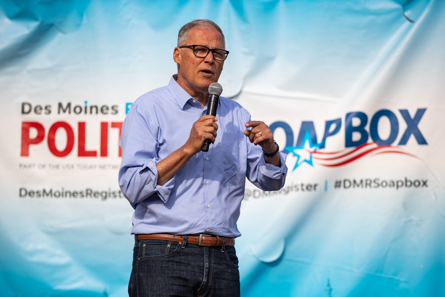 Washington Gov. Jay Inslee speaks at the Des Moines Register Political Soapbox during the Iowa State Fair in Des Moines, IA on Saturday, August 10, 2019.