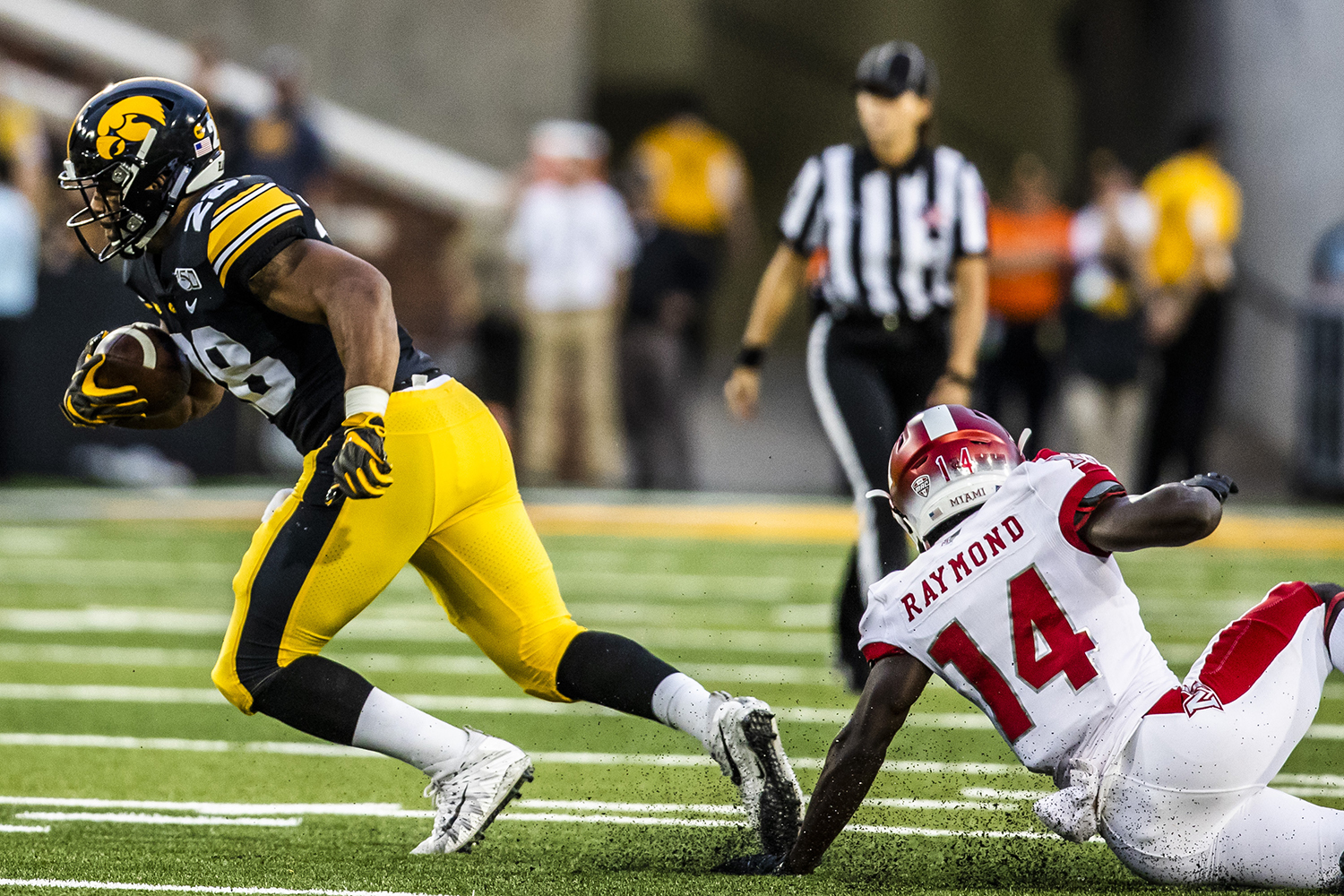 Iowa+running+back+Toren+Young+breaks+away+from+Miami+%28Ohio%29+defensive+back+Zedrick+Raymond+during+their+game+at+Kinnick+Stadium+on+Saturday%2C+August+31%2C+2019.+The+Hawkeyes+defeated+the+Redhawks+38-14.