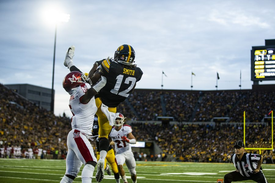 Iowa wide receiver Brandon Smith catches an out of bounds pass during the Iowa football game against Miami (Ohio) at Kinnick Stadium on Saturday, August 31, 2019. The Hawkeyes defeated the Redhawks 38-14.
