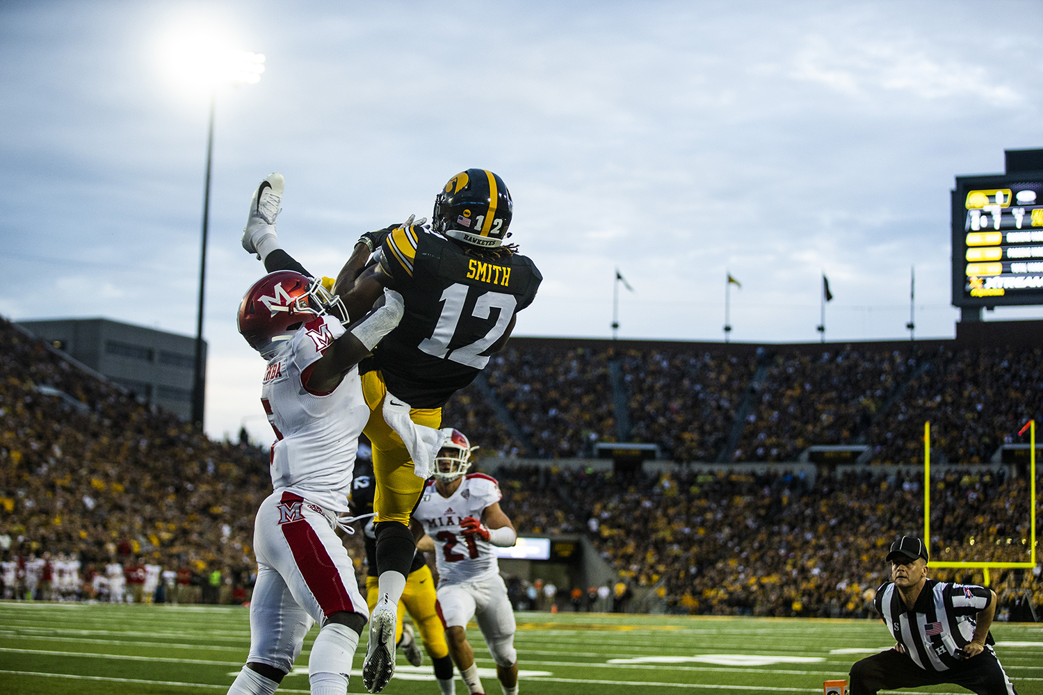 Iowa+wide+receiver+Brandon+Smith+catches+an+out+of+bounds+pass+during+the+Iowa+football+game+against+Miami+%28Ohio%29+at+Kinnick+Stadium+on+Saturday%2C+August+31%2C+2019.+The+Hawkeyes+defeated+the+Redhawks+38-14.