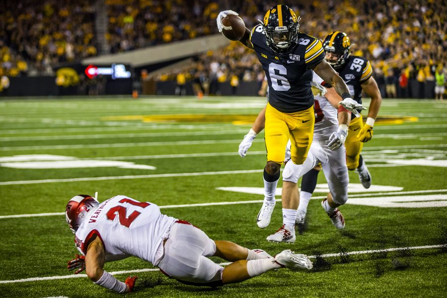 Iowa+wide+receiver+Ihmir+Smith-Marsette+jumps+over+Miami+%28Ohio%29+defensive+back+Sterling+Weatherford+during+the+Iowa+football+game+against+Miami+%28Ohio%29+at+Kinnick+Stadium+on+Saturday%2C+August+31%2C+2019.+The+Hawkeyes+defeated+the+Redhawks+38-14.