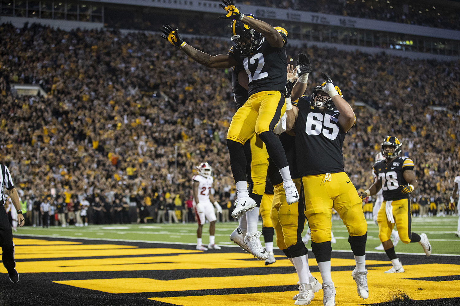 Iowa wide receiver Brandon Smith celebrates making Iowa's first touchdown of the game during Iowa football vs. Miami (Ohio) at Kinnick Stadium on Aug. 31, 2019. Iowa defeated the Miami (Ohio) 38-14.