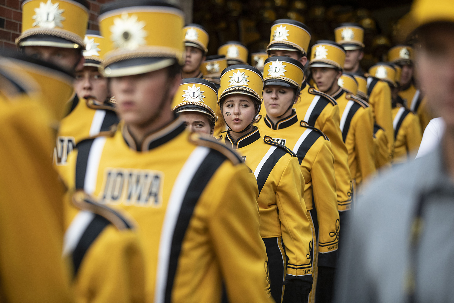 Members of the Hawkeye Marching Band come out of the Northwest tunnel during Iowa football vs. Miami (Ohio) at Kinnick Stadium on Aug. 31, 2019. Iowa defeated the Miami (Ohio) 38-14.