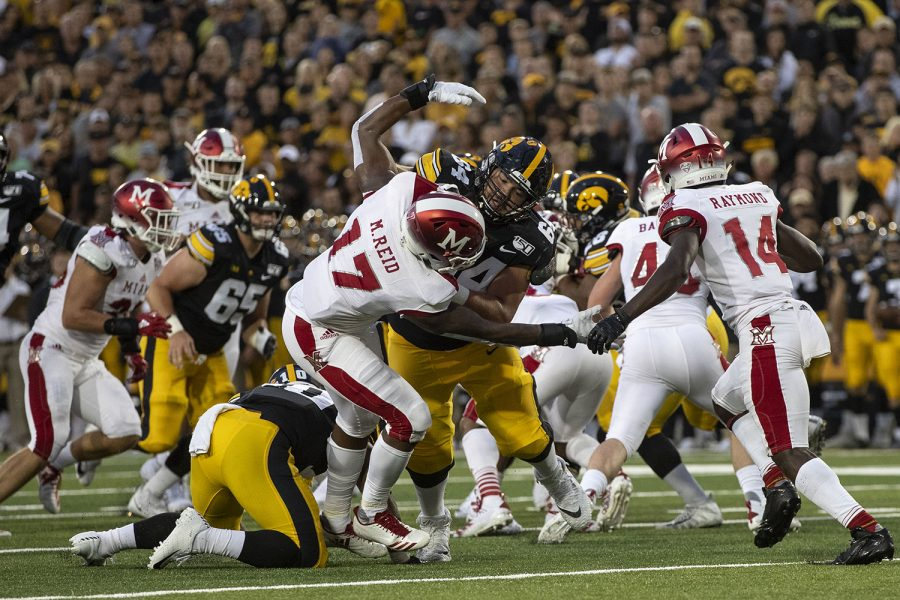 Iowa+offensive+lineman+Kyler+Schott+blocks+Miami+%28Ohio%29+linebacker+Myles+Reid+during+Iowa+football+vs.+Miami+%28Ohio%29+at+Kinnick+Stadium+on+Aug.+31%2C+2019.+Iowa+defeated+the+Miami+%28Ohio%29+38-14.