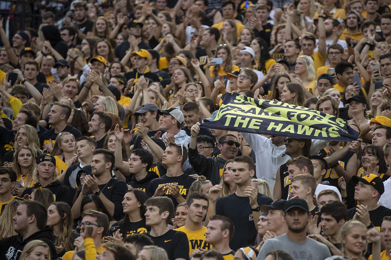 Fans+hold+a+%E2%80%9CSaturdays+are+for+the+Hawks%E2%80%9D+flag+during+Iowa+football+vs.+Miami+%28Ohio%29+at+Kinnick+Stadium+on+Aug.+31%2C+2019.+Iowa+defeated+the+Miami+%28Ohio%29+38-14.