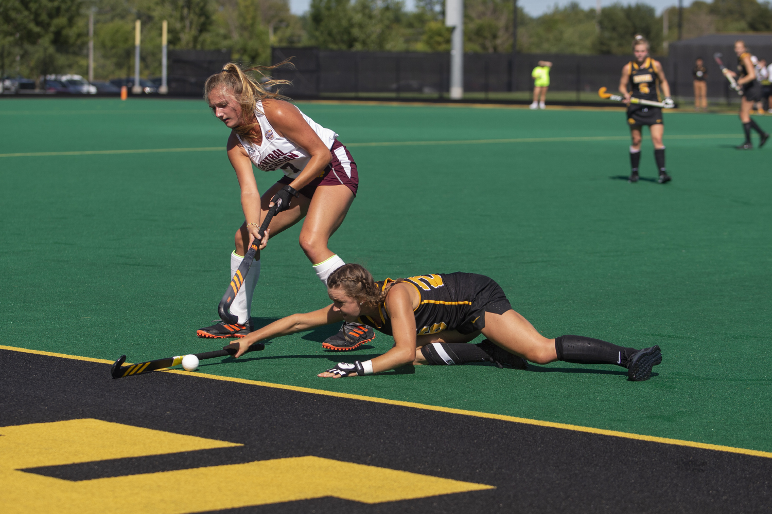 Iowa+forward+Maddy+Murphy+tries+to+keep+the+ball+inside+the+sideline+during+a+field+hockey+game+between+Iowa+and+Central+Michigan+at+Grant+Field+on+Friday%2C+September+6%2C+2019.+The+Hawkeyes+defeated+the+Chippewas%2C+11-0.