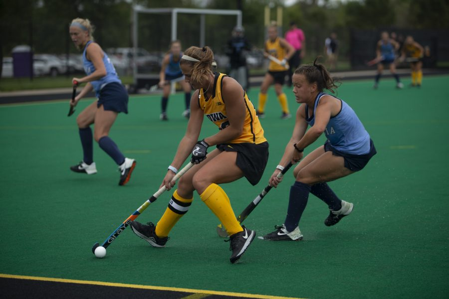 Iowa+midfielder+Sophie+Sunderland+protects+the+ball+during+a+field+hockey+game+between+Iowa+and+Columbia+at+Grant+Field+on+Sunday%2C+September+8%2C+2019.+The+Hawkeyes+defeated+the+Lions%2C+3-1.