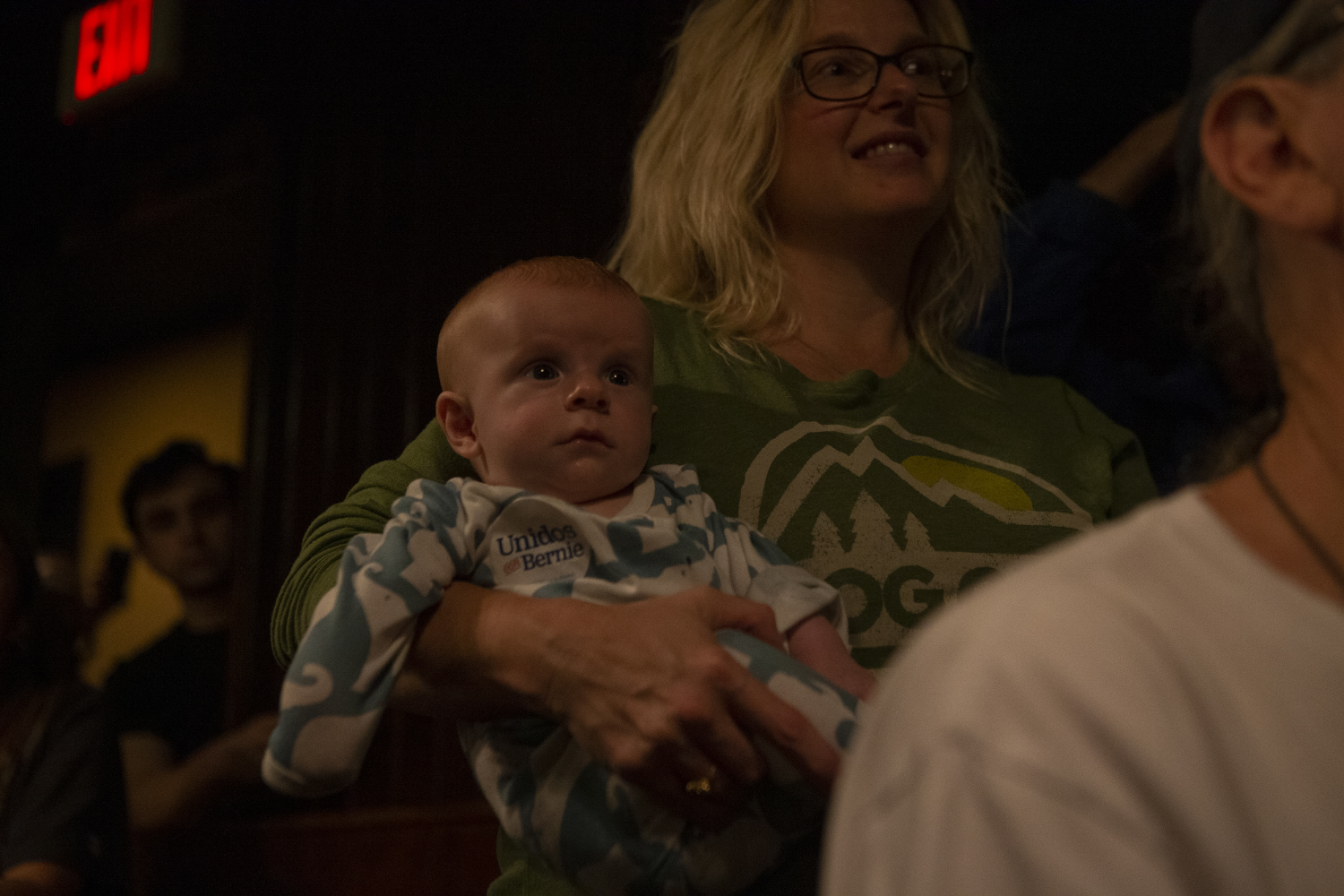 An+attendee+holds+a+baby+during+Bernie+Sanders%E2%80%99s+Loter%C3%ADa+Night+with+LULAC+on+Sunday%2C+September+8%2C+2019+at+The+Mill.
