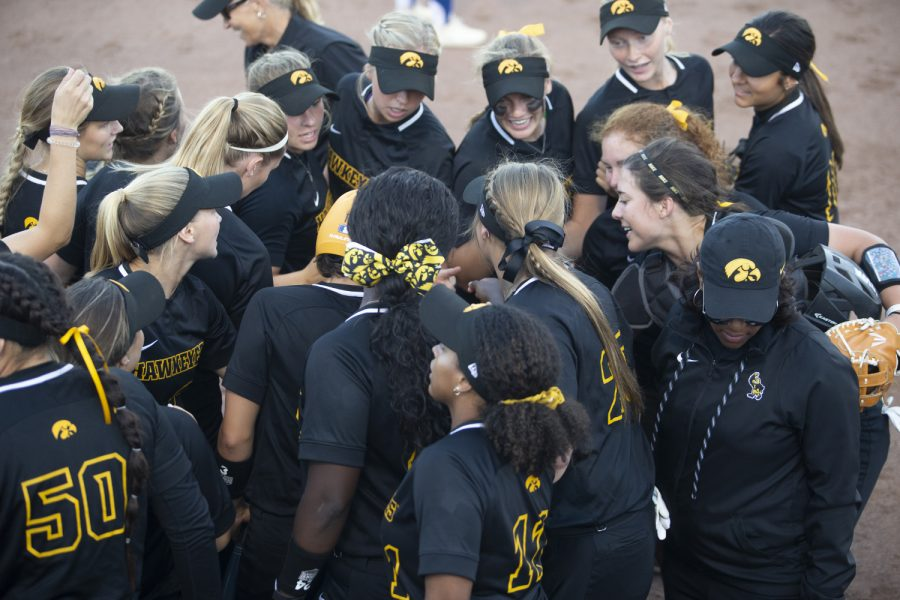 Team+members+do+a+cheer+in+between+innings+during+the+Iowa+softball+fall+opener+against+Des+Moines+Area+Community+College+on+Friday%2C+Sept.+13%2C+2019.+The+Hawkeyes+beat+the+Bears+4-1+in+10+innings.