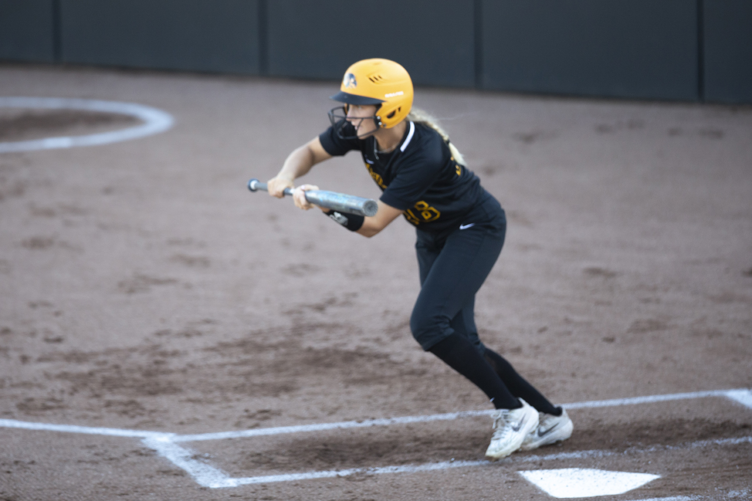 Infielder Mia Ruther bunts during the Iowa softball fall opener against Des Moines Area Community College. The Hawkeyes beat the Bears 4-1 in 10 innings.