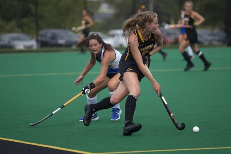 Iowa midfielder Sofie Stribos runs with the ball during a field hockey game between Iowa and Duke at Grant Field on Sunday, September 15, 2019. The Hawkeyes were defeated by the Blue Devils, 2-1 after two overtime periods.