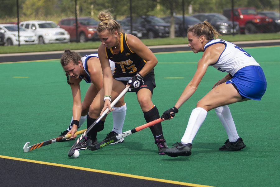 Iowa+forward+Leah+Zellner+tries+to+shield+the+ball+from+two+Duke+players+during+a+field+hockey+game+at+Grant+Field+on+Sunday%2C+September+15%2C+2019.+The+Hawkeyes+were+defeated+by+the+Blue+Devils%2C+2-1+after+two+overtime+periods.