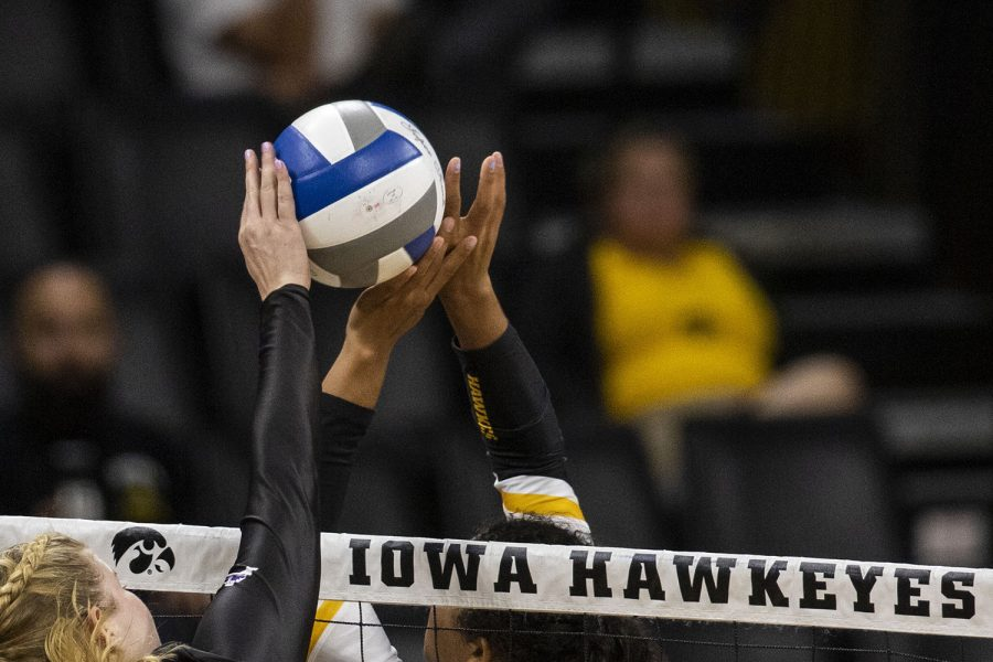 Iowa%E2%80%99s+Brie+Orr+sets+the+ball+over+the+net+during+an+Iowa+vs.+Lipscomb+volleyball+game+at+Carver-Hawkeye+Arena+on+Friday+Sept.+20%2C+2019.+The+Hawkeyes+defeated+the+Bisons+3-0.+Orr+had+32+assists+during+the+game.