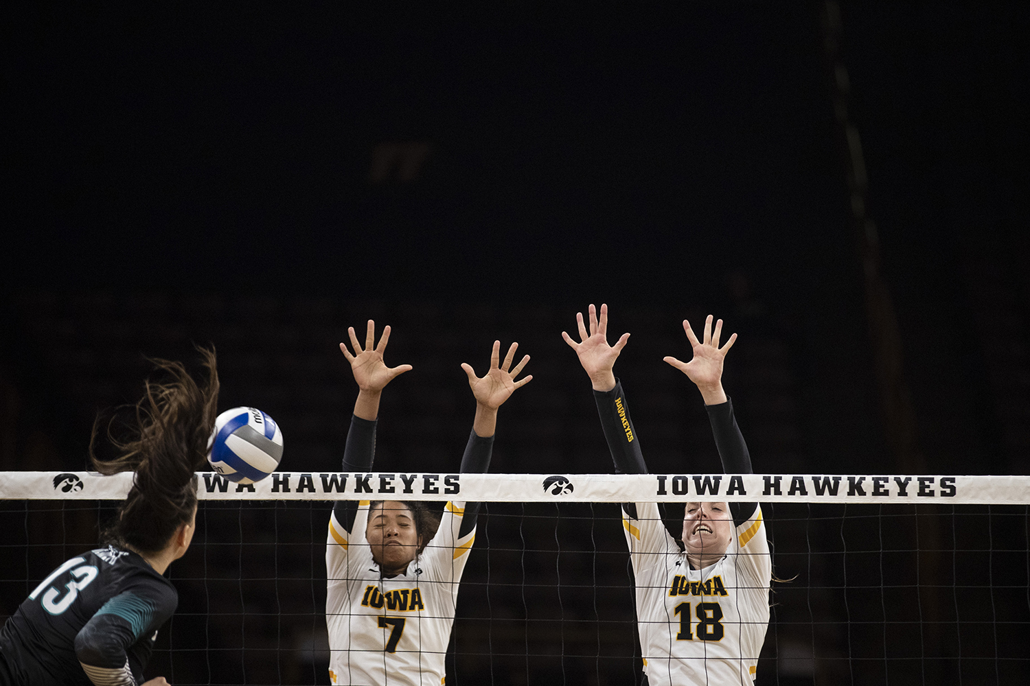 Iowa's Brie Orr and Hannah Clayton jump up to block a spike at a volleyball game against Coastal Carolina at Carver Hawkeye Arena on Friday, September 20, 2019. The Chanticleers defeated the Hawkeyes 3-1.