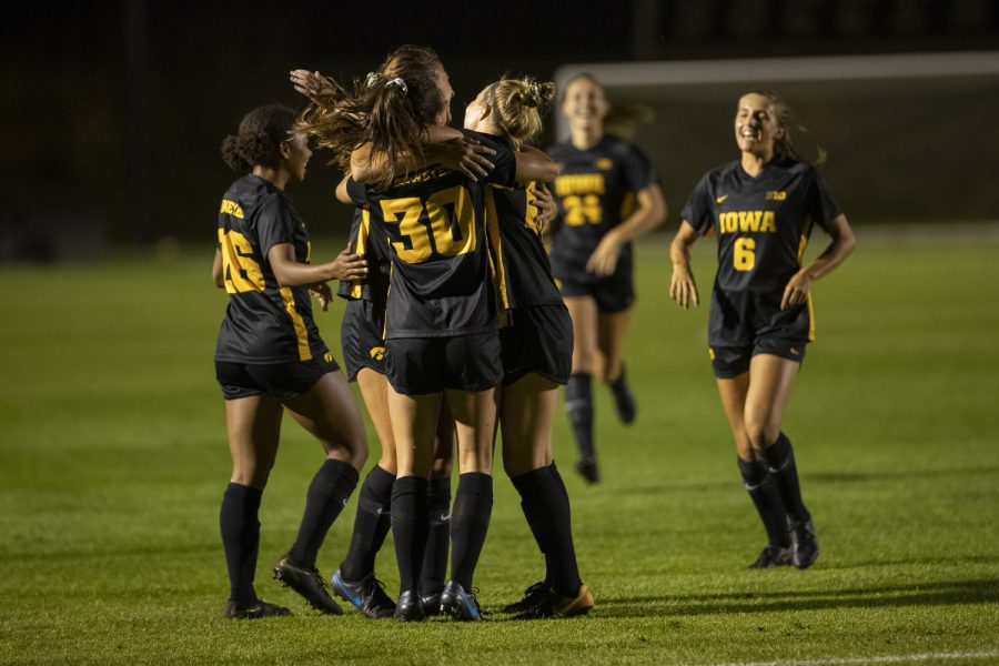 Iowa players hug after a goal during a soccer game between Iowa and Illinois on Sept. 26, 2019 at the Iowa Soccer Complex. The Hawkeyes defeated the Fighting Illini, 3-1.