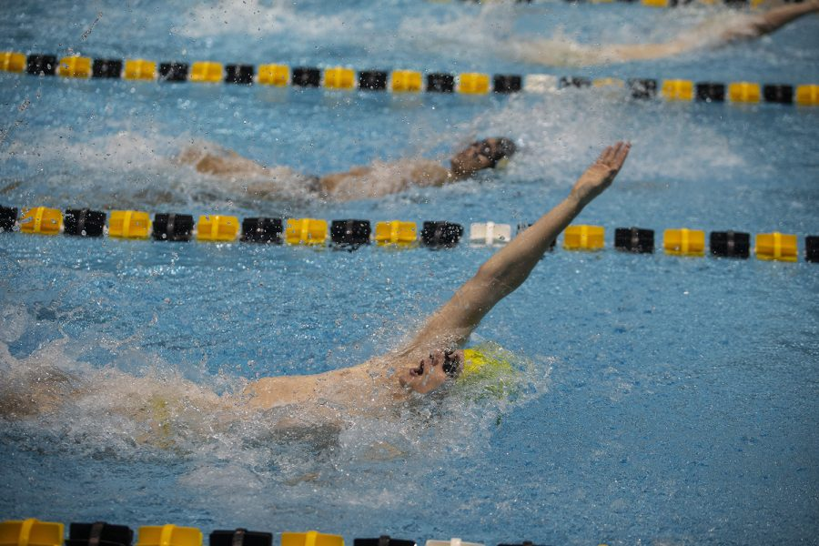 Jacob+Rosenkoetter+competes+in+the+Men%E2%80%99s+100+backstroke+during+an+intrasquad+meet+at+the+Campus+Recreation+and+Wellness+Center+on+Saturday+Sept.+28%2C+2019.+The+Gold+team+defeated+the+Black+team+109.0-83.0.+Rosenkoetter+placed+fourth+with+a+time+of+52.47.+