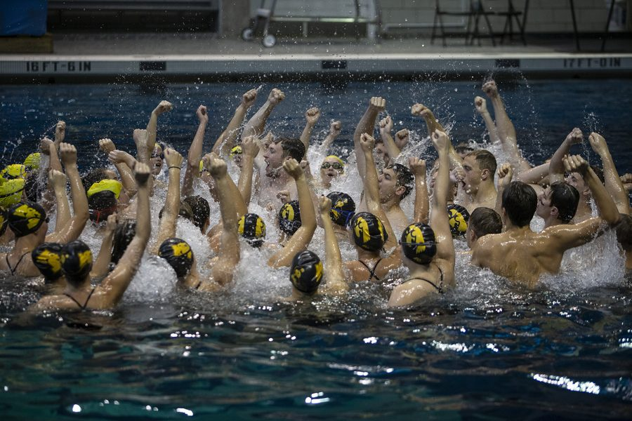 Hawkeyes+sing+the+fight+song+after+an+intrasquad+meet+at+the+Campus+Recreation+and+Wellness+Center+on+Saturday+Sept.+28%2C+2019.+The+Gold+team+defeated+the+Black+team+109.0-83.0.+