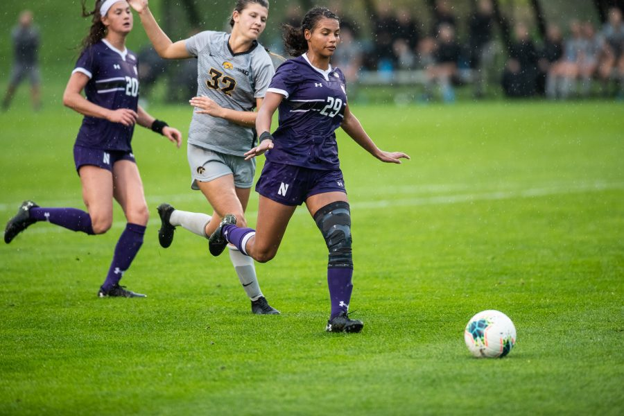 Northwestern Defender Danika Austin keeps the ball away from Iowa Forward Gianna Gourley during the Iowa Women's Soccer game versus Northwestern at the Hawkeye Soccer Complex in Iowa City on Sunday, September 29, 2019. The Wildcats defeated the Hawkeyes 2-1 in overtime.