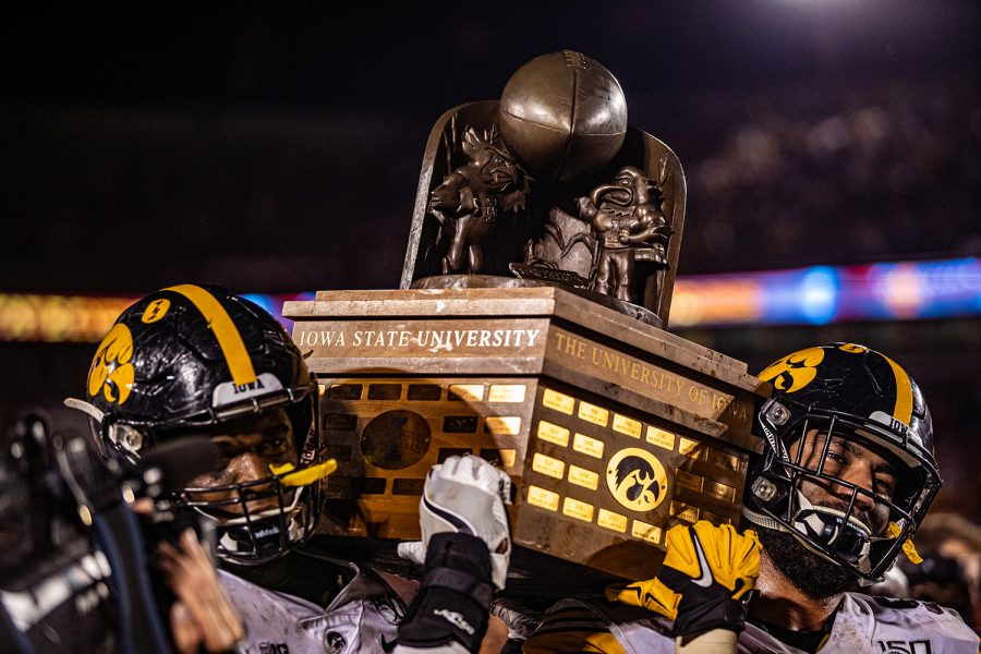 Iowa+players+hoist+the+Cy-Hawk+trophy+during+a+football+game+between+Iowa+and+Iowa+State+at+Jack+Trice+Stadium+in+Ames+on+Saturday%2C+September+14%2C+2019.+The+Hawkeyes+retained+the+Cy-Hawk+Trophy+for+the+fifth+consecutive+year%2C+downing+the+Cyclones%2C+18-17.+%28Shivansh+Ahuja%2FThe+Daily+Iowan%29