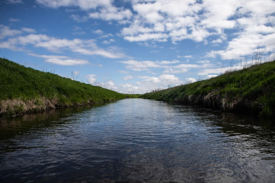 A narrow section of the Iowa River's west branch is seen on May 20, 2019. The expedition, which spanned 27 days covered the entire length of the 329 mile river, sought to provide insight into issues of water quality within the state. Along the way, Daily Iowan Photojournalist Ryan Adams conducted nitrate tests of the water, talked with Iowa citizens from a diverse set of backgrounds to understand how Iowans view the issue. (Ryan Adams/The Daily Iowan)