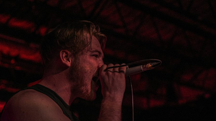 University of Iowa student Joe Gephart performs at Gabes in downtown Iowa City on Aug. 17. Gephart is a part of the local metal band NonGrata.