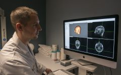 University of Iowa researcher Nicholas Trapp is operating a monitor for his Transcranial Magnetic Stimulation system on Friday, September 13th, 2019. Nicholas and his team is studying transcranial magnetic stimulation (TMS) and how effective the treatment would be in the cases of bipolar disorder, autism, and schizophrenia.