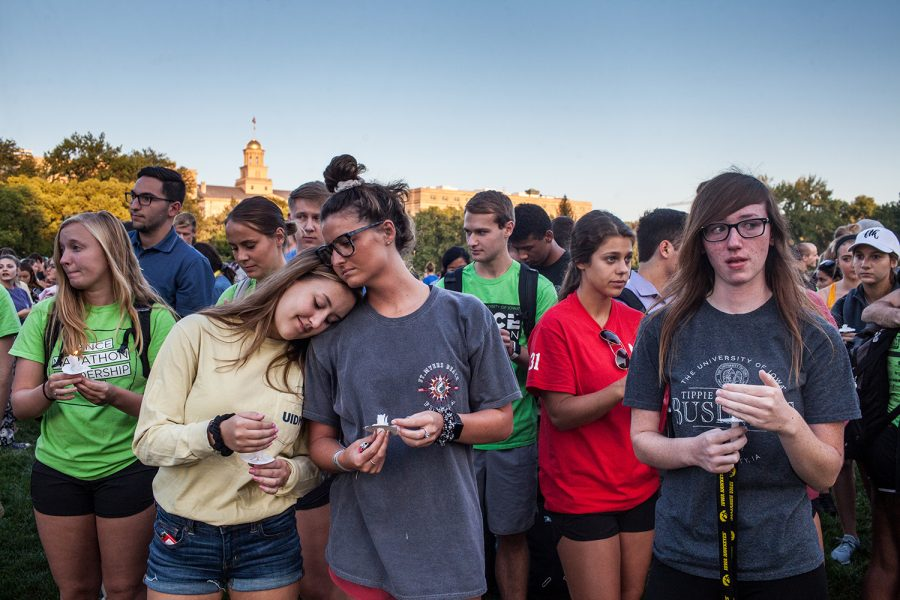Community Members gather to pay their respects during a Vigil for deceased UI student Mollie Tibbetts at Hubbard Park on Wednesday, August 22, 2018. Tibbetts went missing on July 18, in Brooklyn, IA. On Tuesday, authorities recovered her body and filed murder charges against 24-year-old Poweshiek County resident Cristhian Bahena Rivera.