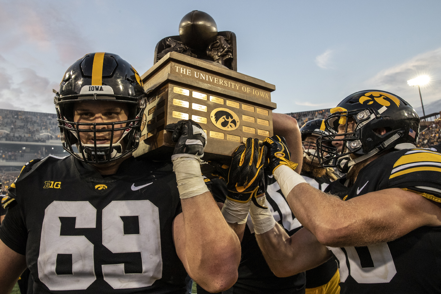 Iowa center Keegan Render and teammates carry the Cy-Hawk trophy off the field after Iowa's game against Iowa State at Kinnick Stadium on Saturday, September 8, 2018.  The Hawkeyes defeated the cyclones 13-3.