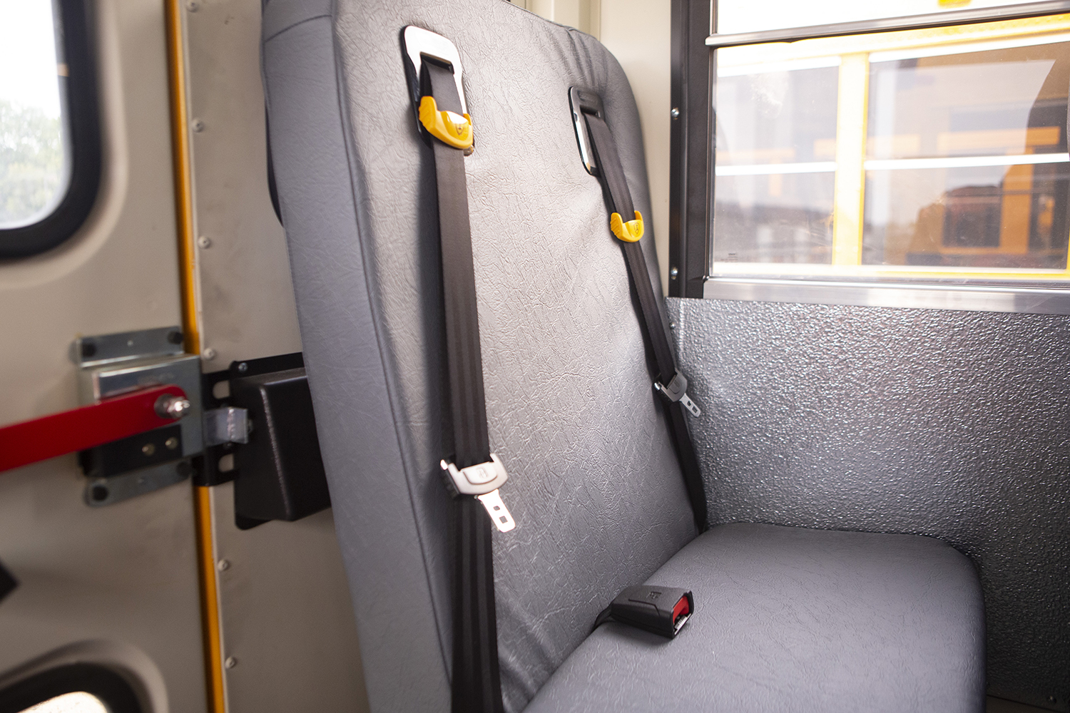 A seatbelt is seen on an Iowa City Community Schools bus on Wednesday, Sept. 18, 2019.