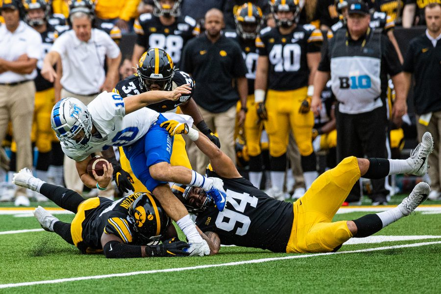 Iowa+defenders+converge+on+MTSU+quarterback+Asher+O%27Hara+during+a+football+game+between+Iowa+and+Middle+Tennessee+State+at+Kinnick+Stadium+on+Saturday%2C+September+28%2C+2019.+The+Hawkeyes+defeated+the+Blue+Raiders%2C+48-3.+