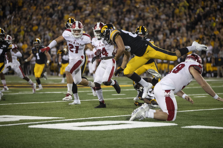 Wide receiver Nico Ragaini attempts to avoid the defense during Iowa football vs. Miami (Ohio) at Kinnick Stadium on Aug. 31, 2019. Iowa defeated the Miami (Ohio) 38-14.