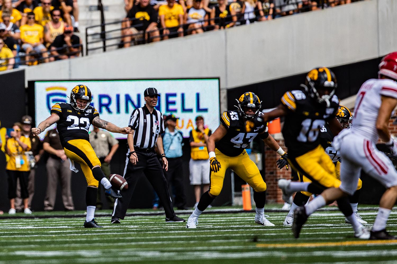 Iowa punter Michael Sleep-Dalton kicks the ball during a football game between Iowa and Rutgers at Kinnick Stadium on Saturday, September 7, 2019. The Hawkeyes defeated the Scarlet Knights, 30-0. (Shivansh Ahuja/The Daily Iowan)