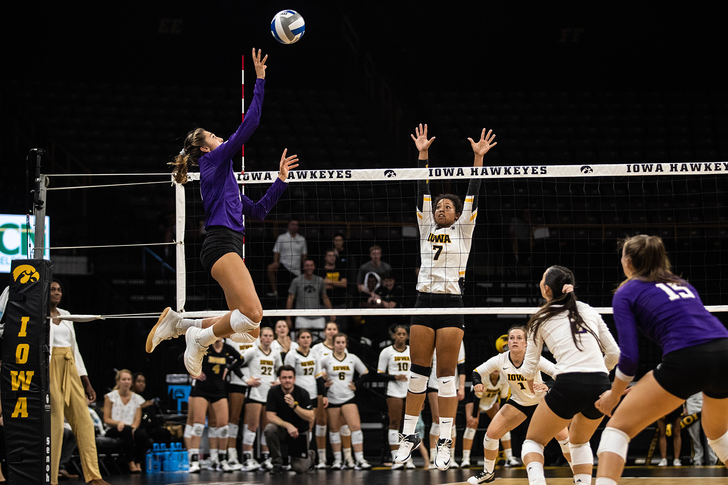 Iowa setter Brie Orr jumps to block a kill during a volleyball match between Iowa and Washington at Carver Hawkeye Arena on Saturday, September 7, 2019. The Hawkeyes were defeated by the Huskies, 3-1.